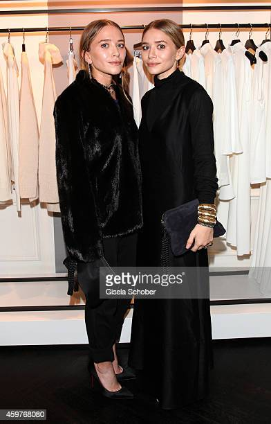 MaryKate Olsen and her twin sister Ashley Olsen pose during MaryKate Olsen and Ashley Olsen present their collection 'The Row' at Marion Heinrich on...