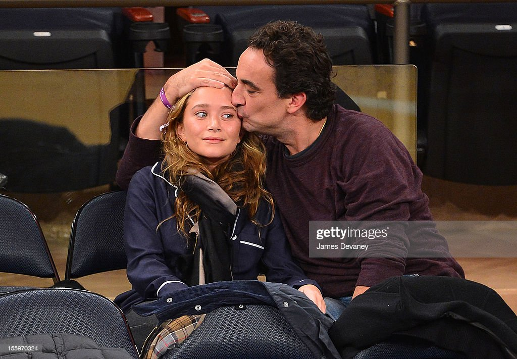 Mary-Kate Olsen and Olivier Sarkozy attend the Dallas Mavericks vs New York Knicks game at Madison Square Garden on November 9, 2012 in New York City.