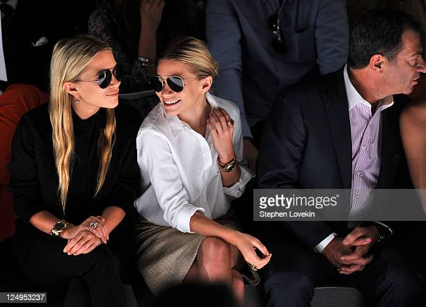 MaryKate Olsen Ashley Olsen and Alec Gores attend the JMendel Spring 2012 Fashion Show at Lincoln Center on September 14 2011 in New York City