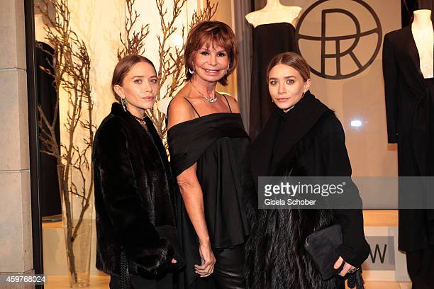 MaryKate Olsen Marion Heinrich and Ashley Olsen pose during MaryKate Olsen and Ashley Olsen present their collection 'The Row' at Marion Heinrich on...