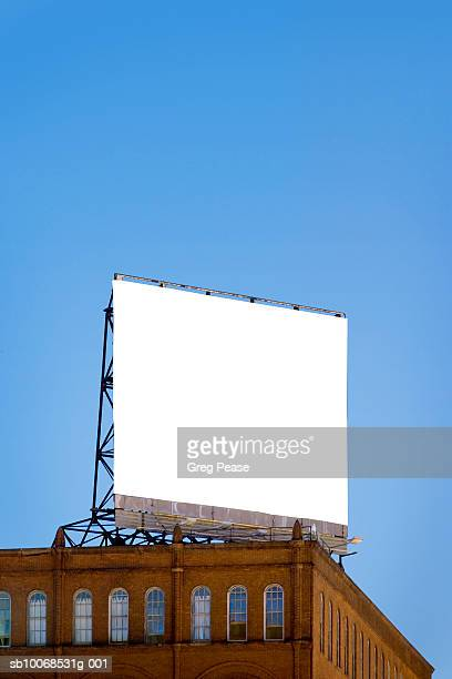 usa, maryland, baltimore, billboard on copycat building, low angle view - vertical stock pictures, royalty-free photos & images