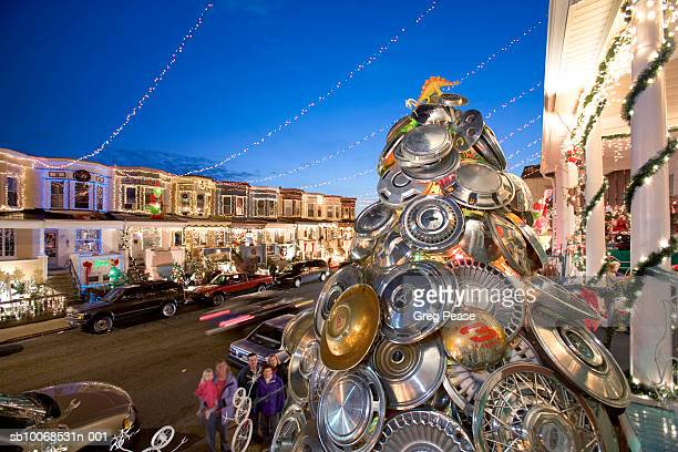USA, Maryland, Baltimore, Hampden Community, 34th Street, Hubcap Christmas tree on sttreet