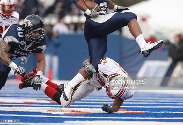 Maryland cornerback Dominique Herald tackles Nevada running back Brandon Fragger in the Roady's Humanitarian Bowl at Bronco Stadium in Boise Idaho on...