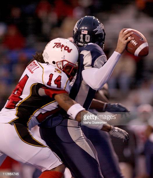 Maryland cornerback Nolan Carroll hits Nevada quarterback Colin Kaepernick resulting in an incomplete pass during the Roady's Humanitarian Bowl at...