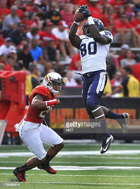 Maryland defensive back Dexter McDougle looks to tackle Old Dominion wide receiver Melvin Vaughn in the first half at Byrd Stadium in College Park...