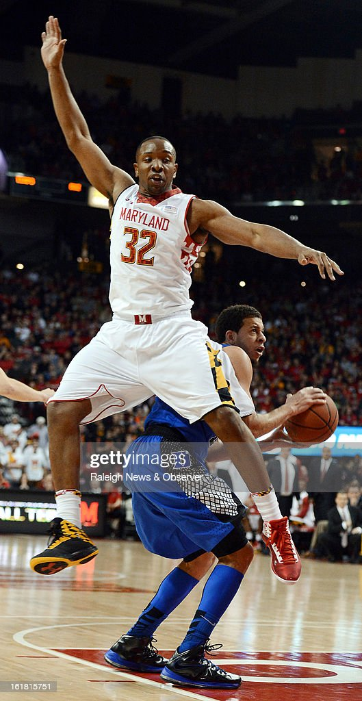 Maryland forward Dez Wells (32) flies past Duke guard Seth Curry (30) in the second half at the Comcast Center in College Park, Maryland, Saturday, January 16, 2013. Maryland upset Duke, 83-81.