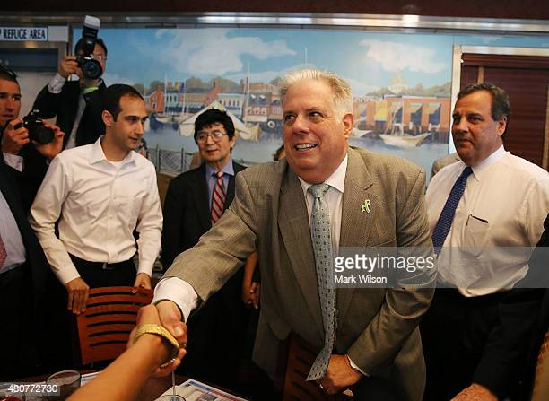 Maryland Gov Larry Hogan and Republican presidentail candidate New Jersey Gov Chris Christie greet patrons during a campaign stop at the Double T...