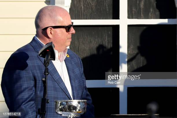 Maryland Gov. Larry Hogan waits to present to the trophy in the winners circle following the 145th running of the Preakness Stakes at Pimlico Race...
