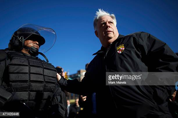 Maryland Governor Larry Hogan greets Baltimore police dressed in riot gear the morning after citywide riots following the funeral of Freddie Gray, on...