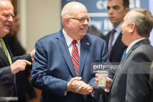 Maryland Governor Larry Hogan speaks with attendees before being introduced at the New Hampshire Institute of Politics as he mulls a Presidential run...