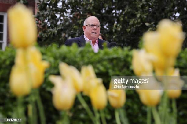Maryland Governor Larry Hogan talks to reporters during a news briefing about the ongoing novel coronavirus pandemic in front of the Maryland State...