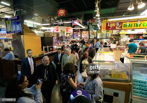 Maryland Governor Larry Hogan tours the Lexington Market on May 6 2015 in Baltimore Maryland Hogan announced earlier at a news conference he had...