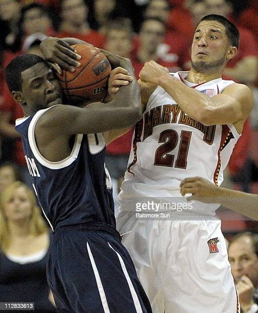 Maryland guard Greivis Vasquez battles New Hampshire guard Russell Graham for the ball in the first half at the Comcast Center in College Park...