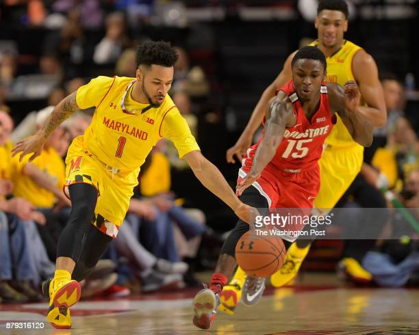 Maryland guard Jaylen Brantley left gathers a loose ball against Ohio State guard Kam Williams during The University of Maryland Terrapins defeat of...