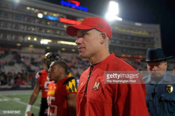 Maryland head coach DJ Durkin walks off the field after the Penn State Nittany Lions defeat of the Maryland Terrapins 66 3 at Maryland Stadium in...