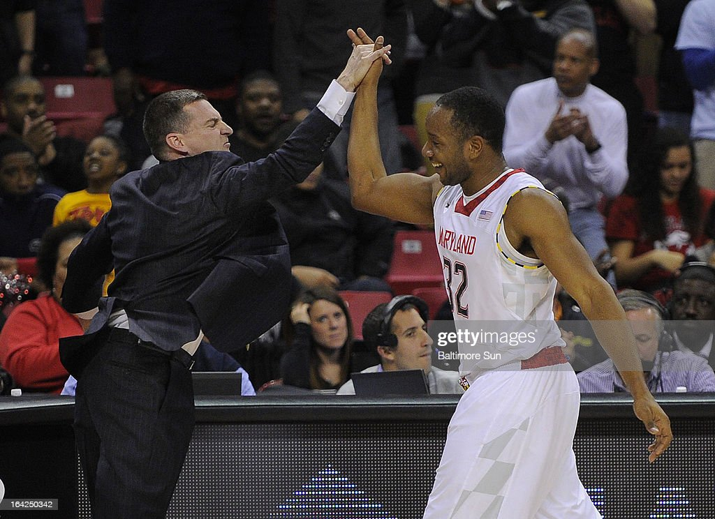 Maryland head coach Mark Turgeon gives his Dez Wells a high-five during the NIT basketball tournament at the Comcast Center in College Park, Maryland. Maryland won, 62-52.