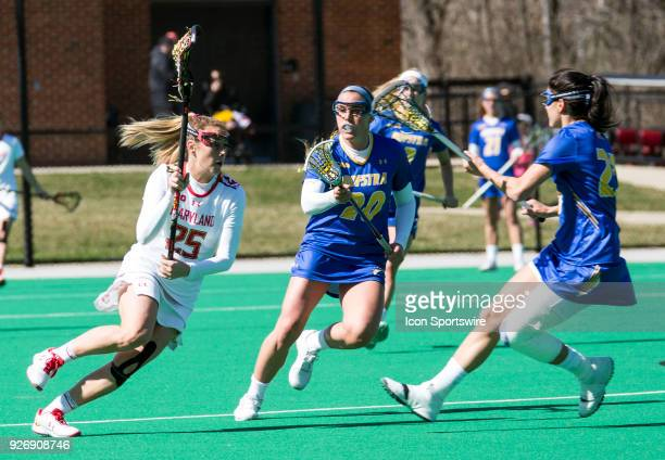 Maryland Lizzie Colson runs at Hofstra Katie Whelan and Alexa Mattera during a women's college Lacrosse game between the Maryland Terrapins and the...