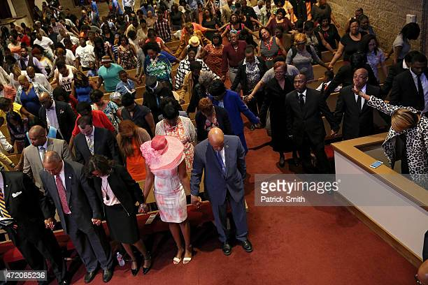 Maryland Lt Gov Boyd Rutherford his wife Monica Maya Rockeymoore wife of Rep Elijah Cummings and Elijah Cummings pray at the Southern Baptist Church...