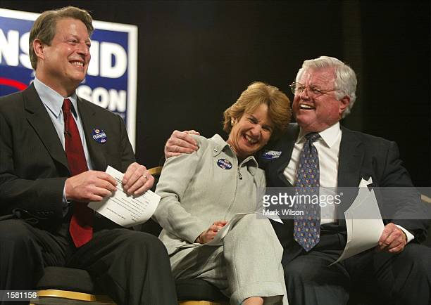Maryland Lt Governor Kathleen Kennedy Townsend gets a hug from her uncle US Senator Ted Kennedy as former vice president Al Gore looks on during a...