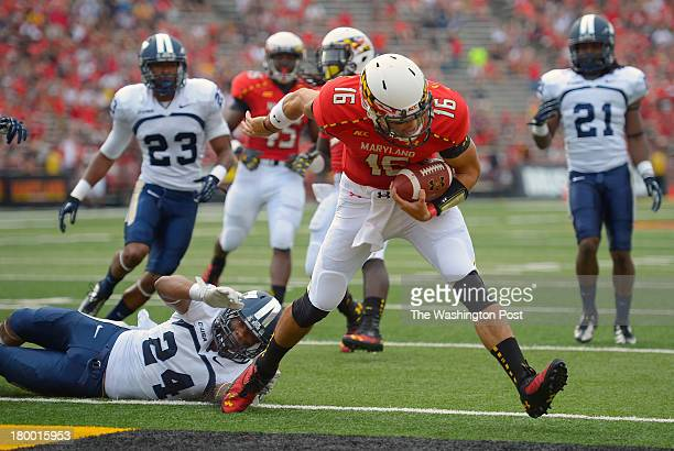 Maryland quarterback CJ Brown center slips past Old Dominion safety Fellonte Misher left for a 2nd Quarter touchdown as the Maryland Terrapins play...