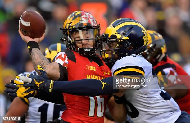 Maryland quarterback Ryan Brand left is hit hard by Michigan linebacker Josh Uche just as her releases the ball in the 2nd quarter as the Maryland...