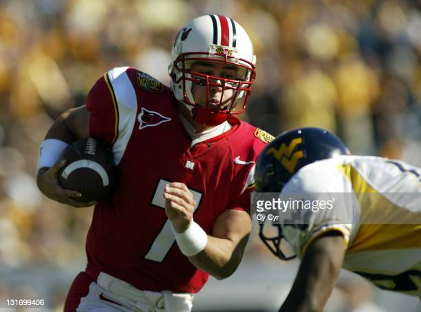 Maryland quarterback Scott McBrien rushes for yards in the first half of action in the 2004 Gator Bowl at Alltel Stadium on January 1st 2004 Maryland...