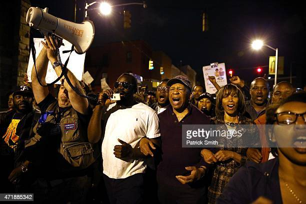 Maryland Rep Elijah Cummings and Maryland state Sen Majority Leader Catherine Pugh march with other protesters after Baltimore authorities released a...