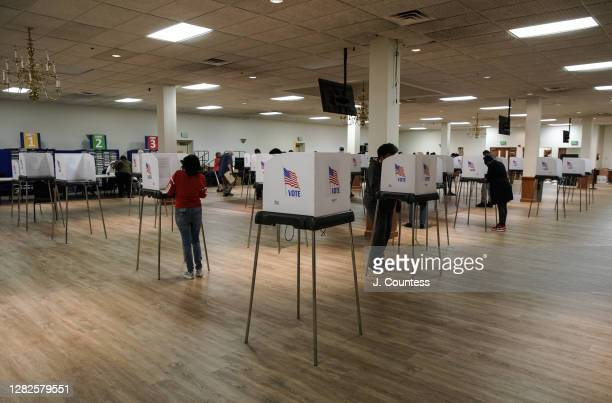 Maryland residents cast their votes at Mount Pleasant Church and Ministries as early voting continues for a second day in the state of Maryland on...