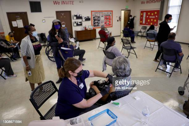 Maryland residents receive the Moderna COVID-19 vaccine through the Anne Arundel County Department of Health at a community COVID-19 vaccination...