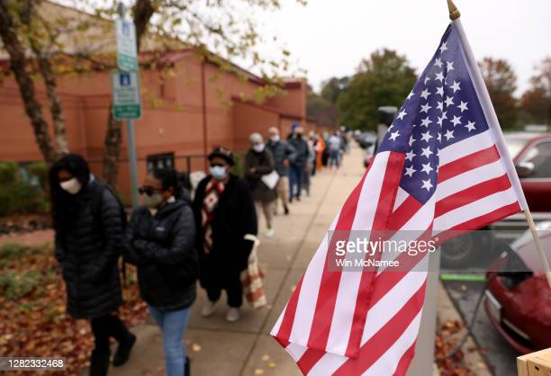Maryland residents wait in line to vote at the Bohrer Park Activity Center on October 26, 2020 in Gaithersburg, Maryland. Today marks the first day...