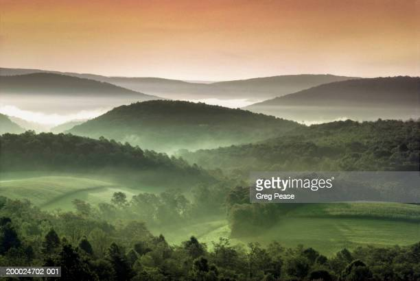 usa, maryland, rolling verdant hills, morning (digital enhancement) - appalachia stock pictures, royalty-free photos & images