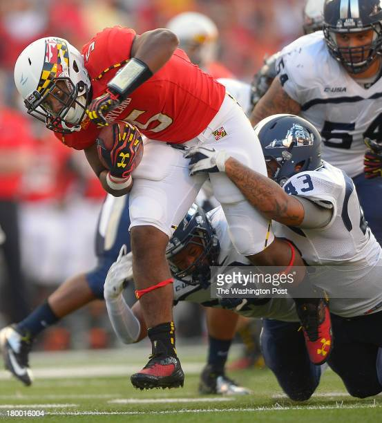 Maryland running back Albert Reid left powers his way to the red zone in the 3rd quarter as the Maryland Terrapins defeat the Old Dominion Monarchs...