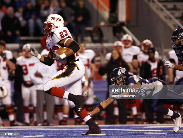Maryland running back Da'Rel Scott breaks off a touchdown run against Nevada in the second half of the Roady's Humanitarian Bowl at Bronco Stadium in...