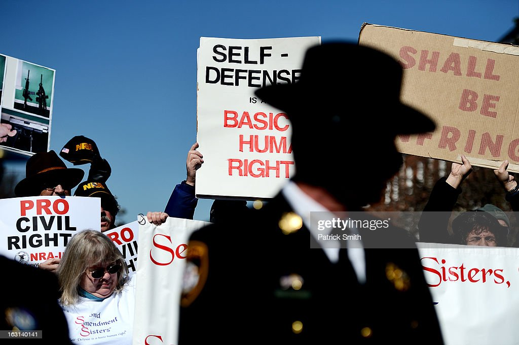 Maryland sheriffs speak as they and other Second Amendment supporters rally against stricter gun control laws at the Maryland State House on March 5, 2013 in Annapolis, Maryland. If the Maryland Firearm Safety Act legislation bill is passed, it would require a license to purchase a handgun, ban the sale of assault style rifles and limit magazine size, among other provisions.