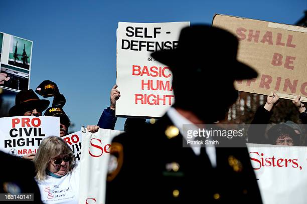Maryland sheriffs speak as they and other Second Amendment supporters rally against stricter gun control laws at the Maryland State House on March 5...
