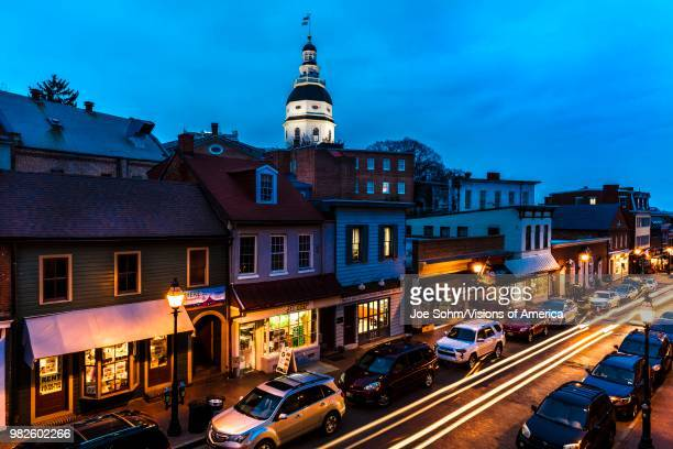 Maryland State Capitol is seen at dusk above Main Street Annapolis Maryland