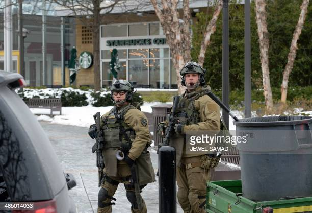 Maryland State police officers patrol the Columbia Mall after a fatal shooting on January 25 in Columbia Maryland Three people were killed in a...