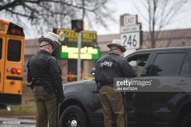 Maryland State Troopers are seen on March 20 2018 at Great Mills High School in Great Mills Maryland after a shooting at the school A shooting took...