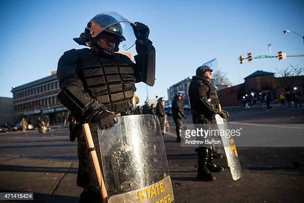 Maryland state troopers stand guard near a CVS pharmacy that was burned to the ground yesterday during rioting after the funeral of Freddie Gray, on...