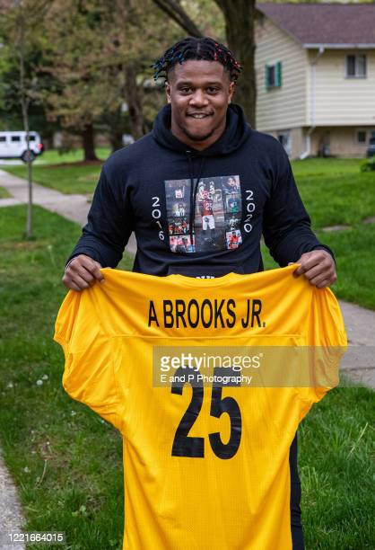 Maryland Terrapins Antoine Brooks Jr poses with his jersey after being drafted in the sixth round by the Pittsburgh Steelers on April 25 2020 at home...