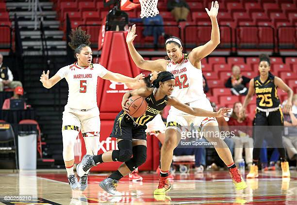Maryland Terrapins center Brionna Jones and guard Destiny Slocum defend against Towson Tigers forward Jordyn Smith during a women's NCAA basketball...