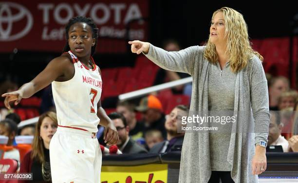 Maryland Terrapins coach Brenda Frese and guard Channise Lewis discuss strategy during a women's college basketball game between the Maryland...