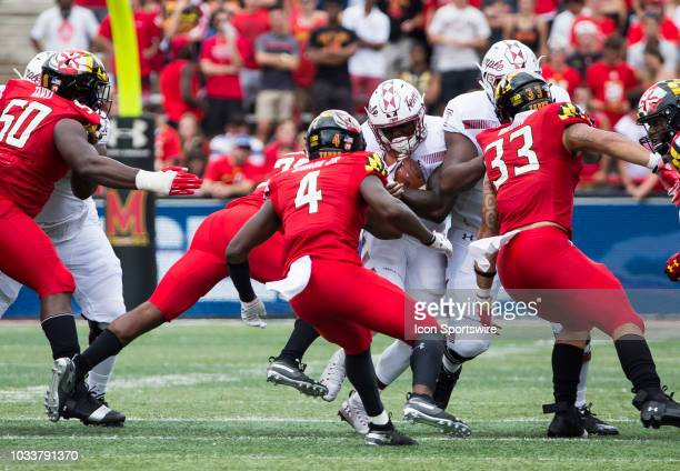 Maryland Terrapins defensive back Darnell Savage Jr and linebacker Tre Watson move up to block Temple Owls running back Ryquell Armstead during a...