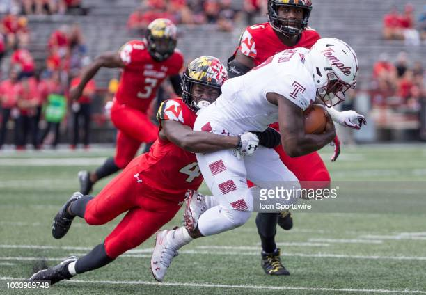 Maryland Terrapins defensive back Darnell Savage Jr hauls down Temple Owls running back Ryquell Armstead during a college football game between the...
