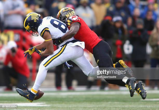 Maryland Terrapins defensive back Darnell Savage Jr Michigan Wolverines wide receiver Grant Perry causing a fumble during a college football game...