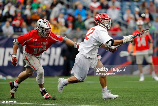 Maryland Terrapins faceoff Jon Garino grabs the ball past Ohio State Buckeyes midfielder Jake Withers during the NCAA Division 1 Men's Championship...