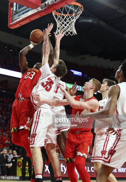 Maryland Terrapins forward Bruno Fernando struggles to get a shot as Wisconsin Badgers forward Nate Reuvers defends during a Big 10 men's basketball...