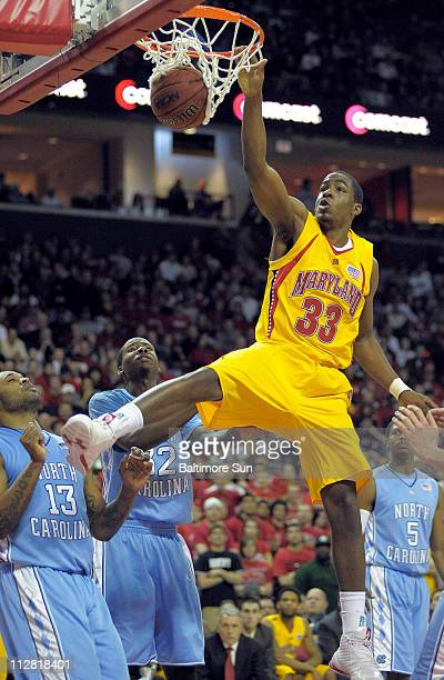 Maryland Terrapins forward Dino Gregory dunks the ball above North Carolina Tar Heels guard/forward Will Graves and forward Ed Davis during the...