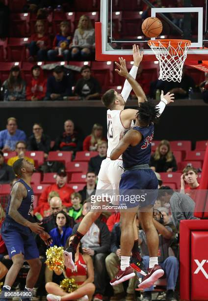 Maryland Terrapins forward Ivan Bender taps in a basket over Fairleigh Dickinson Knights forward Mike Holloway Jr during a college basketball game...