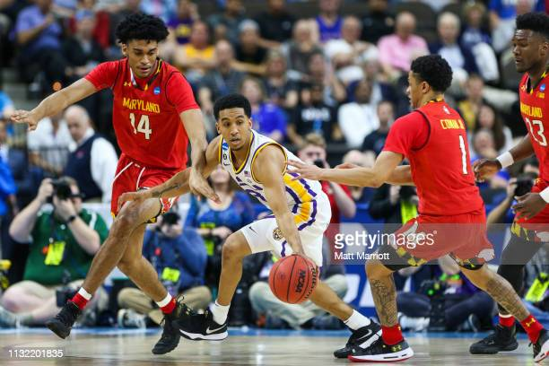 Maryland Terrapins forward Ricky Lindo Jr and Maryland Terrapins guard Anthony Cowan Jr fight for the ball against LSU Tigers guard Tremont Waters...